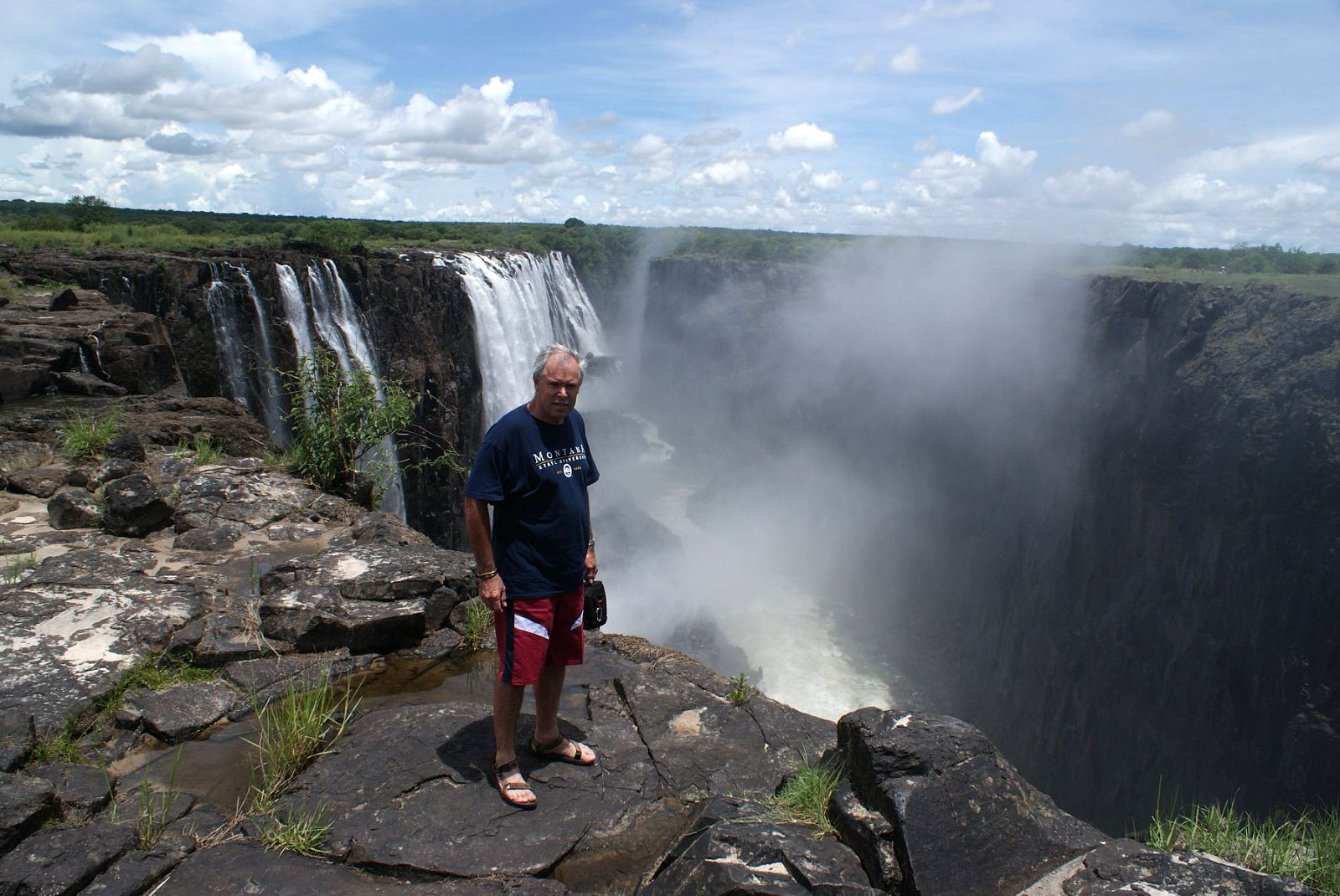 Livingstone_,Roy_looking_over_the_edge_of_Vic_Falls_081